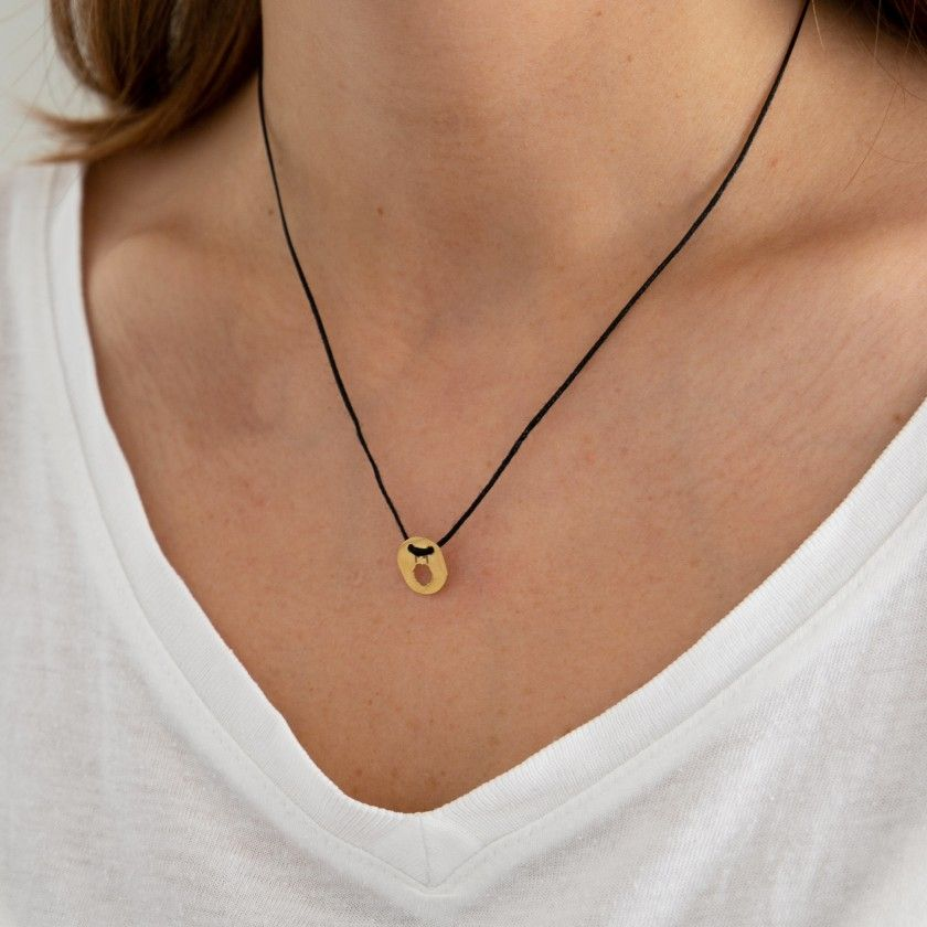 Cord necklace with golden scorpio