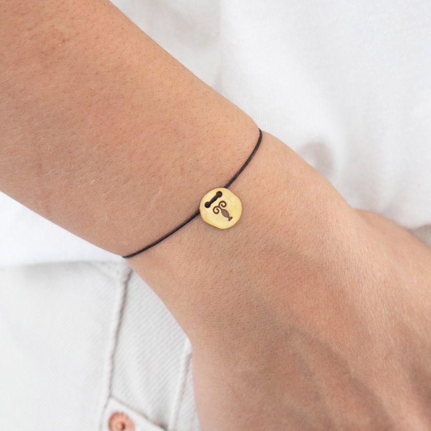 Sagittarius gold with cord bracelet