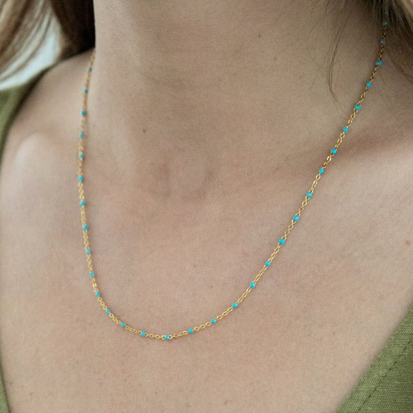 Golden steel necklace with beads