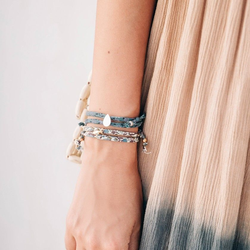 Fabric bracelet with leaf pendant