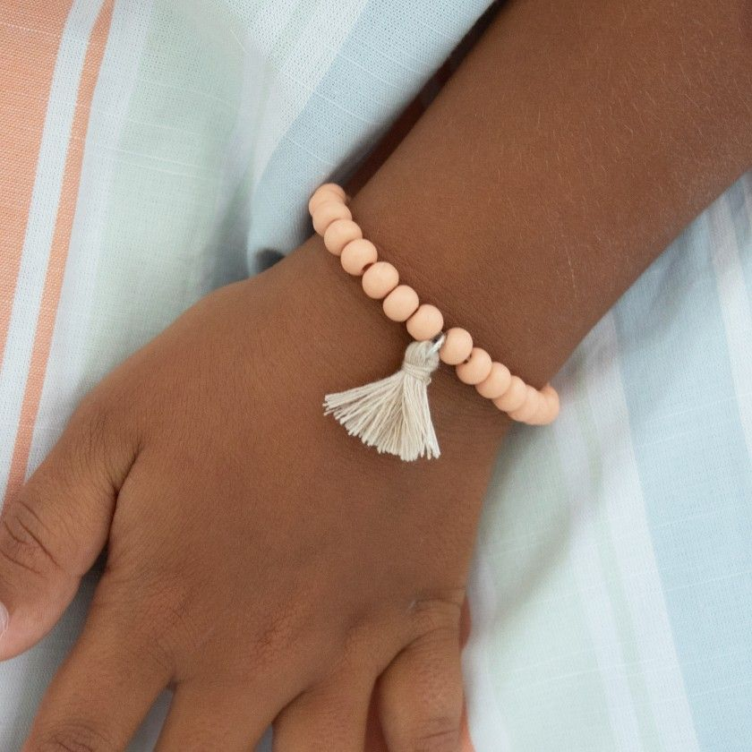 Elastic bracelet with beads and pompom