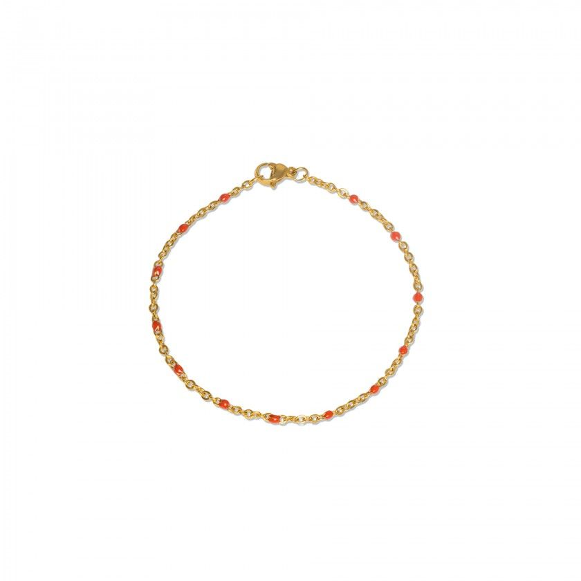 Golden steel bracelet with red beads