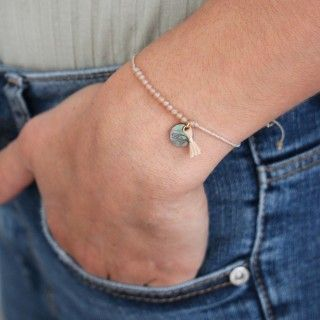 Beaded and pompom bracelet